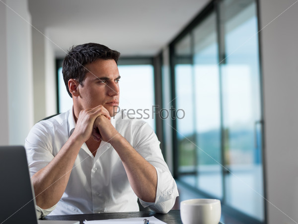 business man working on laptop computer at home