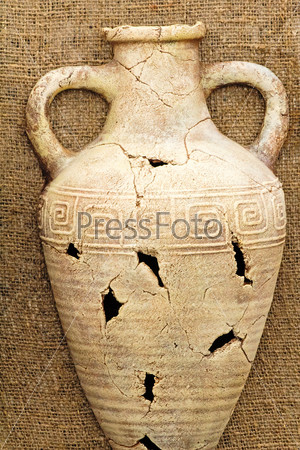The souvenir imitating an ancient amphora from clay.