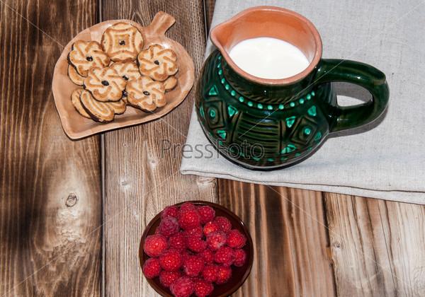 Ripe raspberry and milk jug