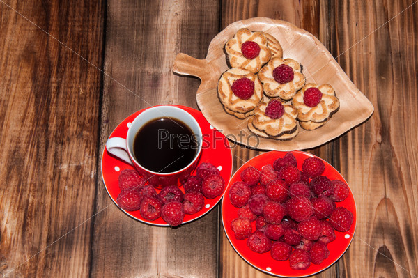 Ripe raspberry and coffee cup,