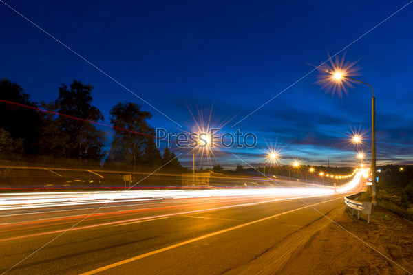 traces of moving cars lights on highway