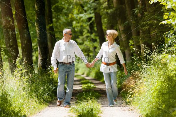 Happy senior couple outdoors running