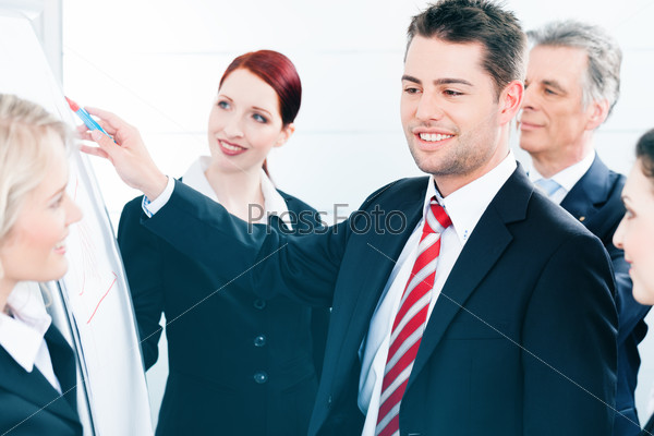 Business Team with leader in office presentation