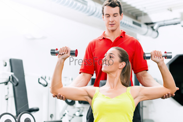 Personal trainer in gym for better fitness