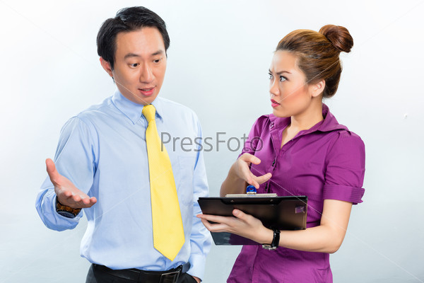 Crisis in Asian business office among colleagues