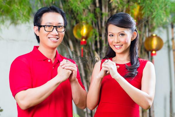 Couple celebrating Chinese new year