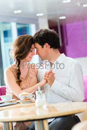 Young couple cafe hugging and kissing