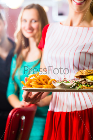 People in American diner or restaurant and waitress