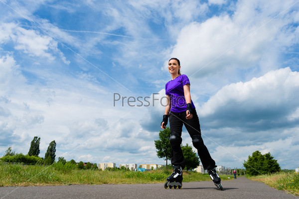Sports outdoor - young woman skating in park