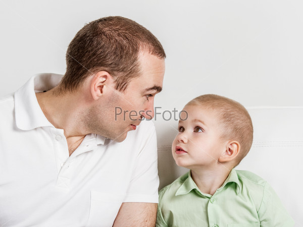 Dad and son look at one another