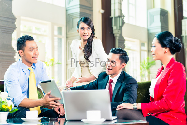 Asian businesspeople having meeting