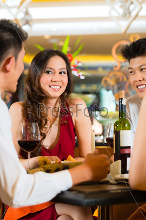 Chinese business people dining in elegant restaurant