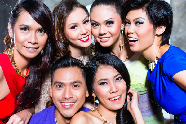 Asian group of party people taking pictures fancy night club