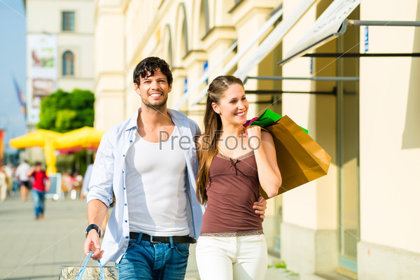 Couple shopping and spending money in city