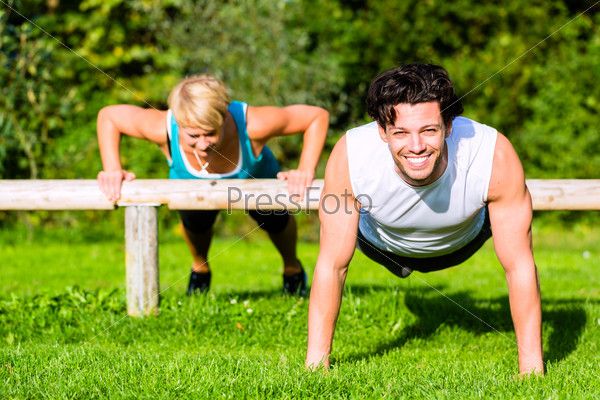 Fitness people doing pushups for sport