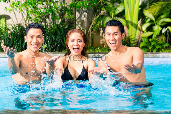 Asian friends swimming in pool