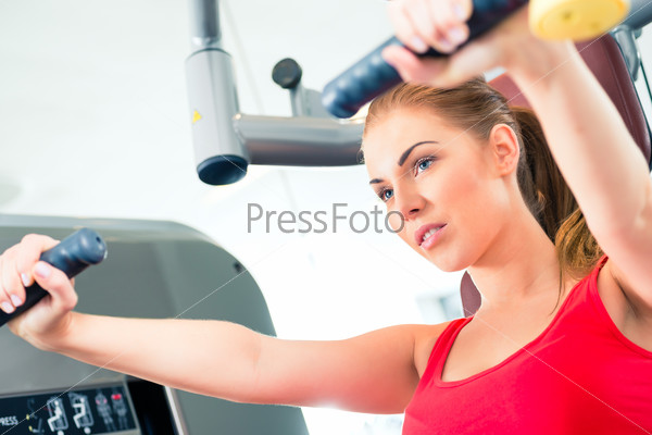 Woman training in gym or sport center