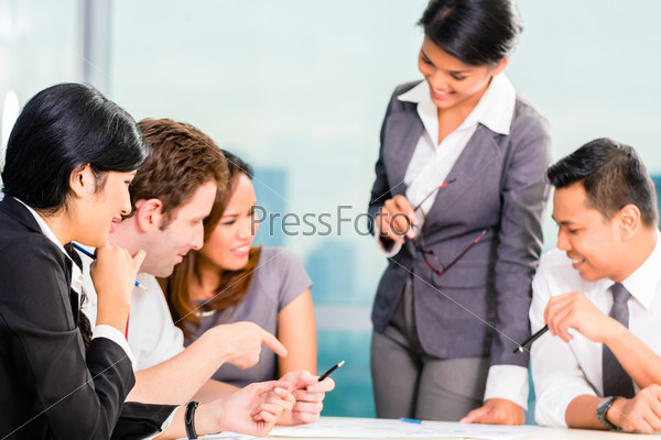Asian Businesspeople having meeting in office