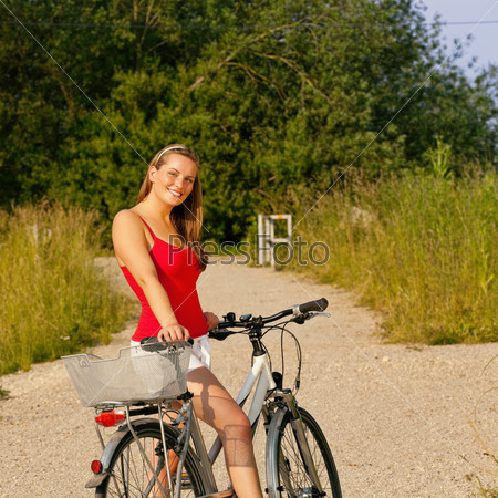 Woman riding her bicycle in summer