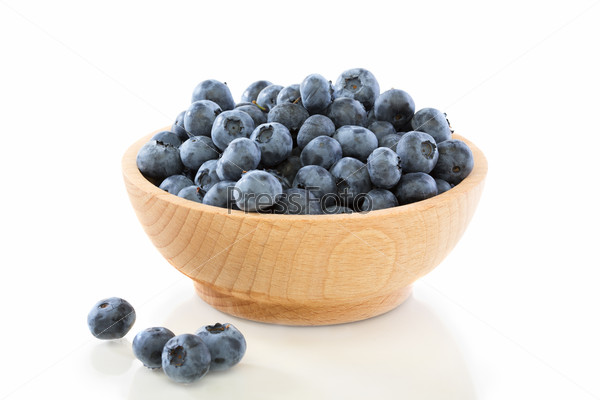 Blueberry fruit in a wooden bowl .
