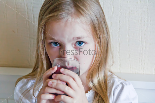 Cute girl drinking beverage