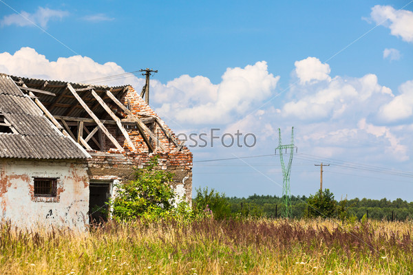 Abandoned farm house in a field