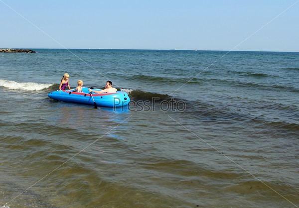 Man with children on the inflatable