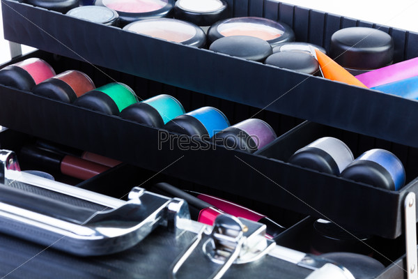 shelves in open makeup case