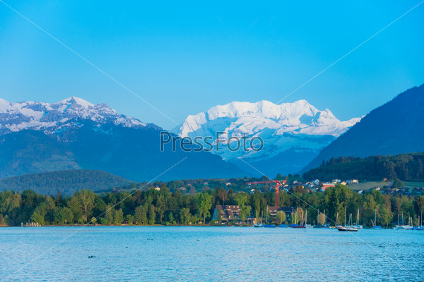 Thun lake and Alps snow caps