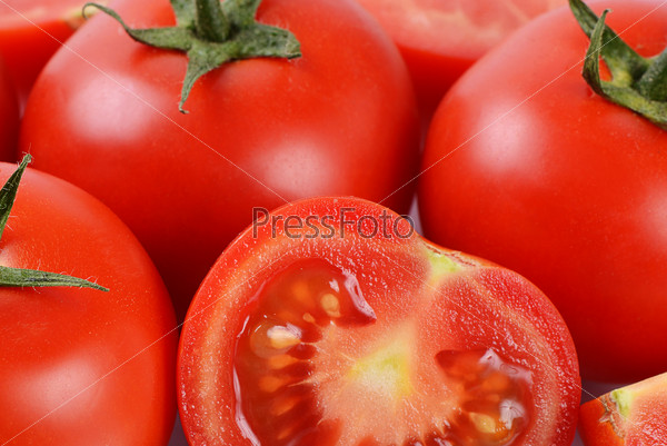 The red fresh tomatoes cut. Macro