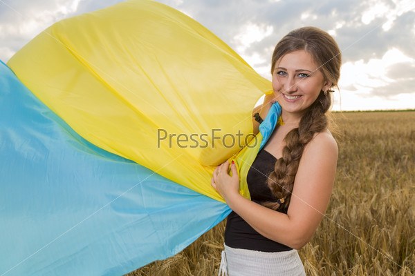 woman with a Ukrainian flag