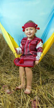 little girl in a wheat field