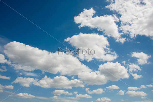 Cloudscape of bright blue sky