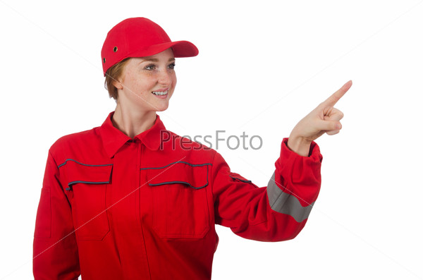 Woman in coveralls pressing virtual button