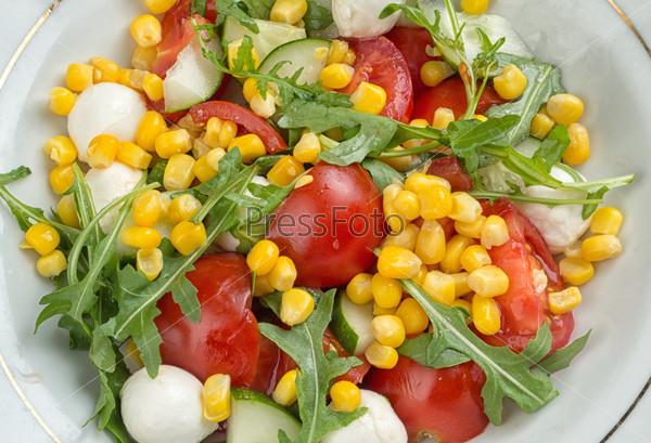 salad with corn, tomato, arugula and mozzarella cheese