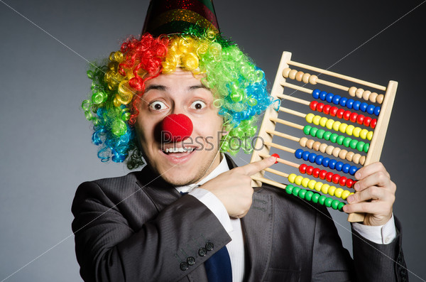 Funny clown businessman with abacus