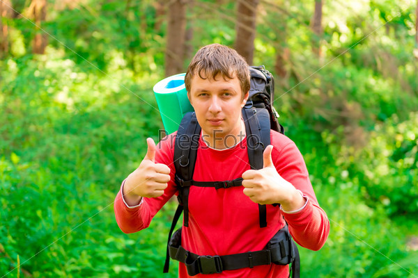 man in a hike enjoys the good weather
