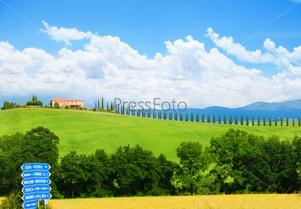 Tuscany landscape with blue sign, house in Italy