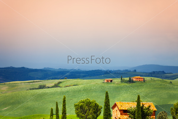 Three houses in Tuscany landscape, Italy