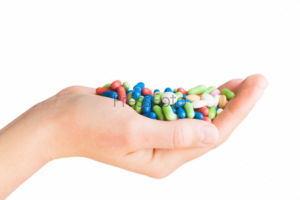 Hand with different pills