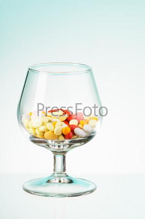 Glass full of pills