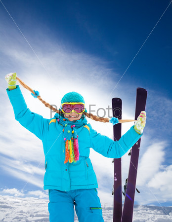 Blond, cute girl on ski winter vacation