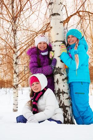 Three girl in birch forest