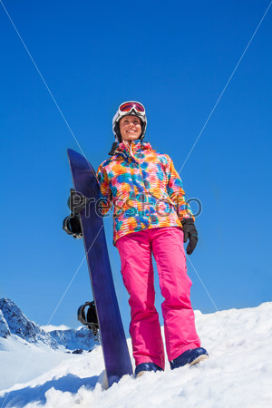 Happy snowboarder woman