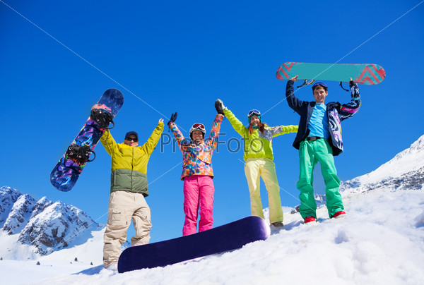 Fiends with snowboard in mountains