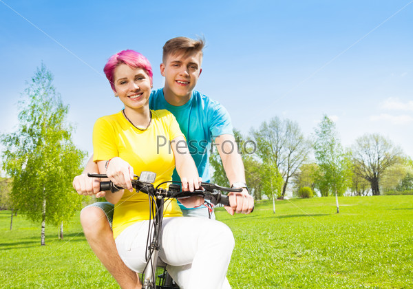 Smiling couple on the bike