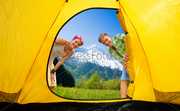 Couple looking into tent