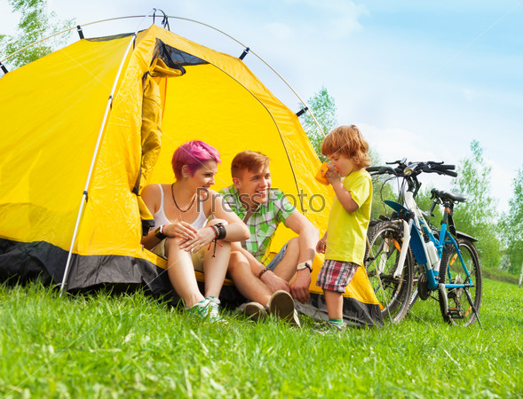 Young family in a tent