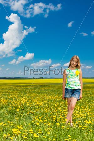 Girl in the dandelion field
