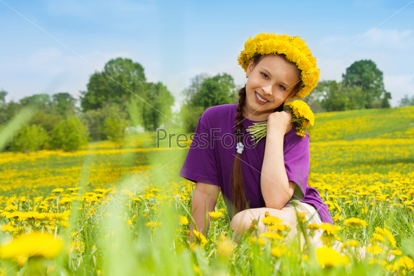 Girl with dandelion bouquet and wreath